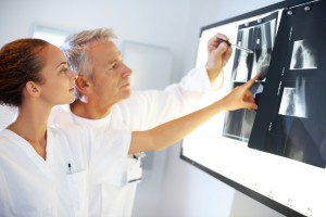 photodune-646537-two-medics-discussing-xray-results-s